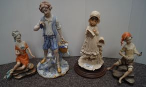 A Capo di Monte boy and girl and two other figures