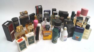 Two boxed bottles of Dunhill eau de toilette and other perfumes