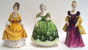 Two Doulton figures and another