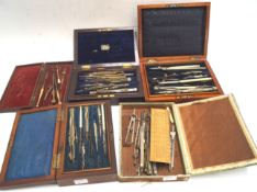 Five boxes of drawing instruments