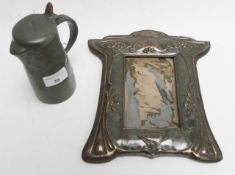 An Art Nouveau style pewter water jug and an Art Nouveau style frame