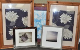 A group of three large picture frames and two framed pictures