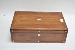 A Victorian mahogany writing slope with mother of pearl inlay,
