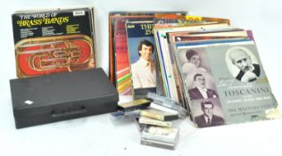A group of assorted vinyl LP's and cassettes