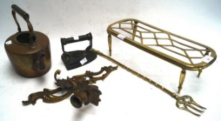 A brass trivet and other items