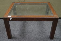 A glass topped oak coffee table