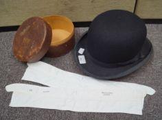 A black bowler hat, a Christy's of London trilby hat,