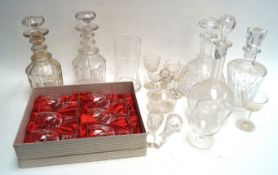 A quantity of cut glass decanters and stoppers and other glass