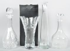 A Thomas Webb cut glass vase with original box along with two decanters and a carafe.