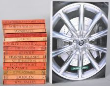A set of fourteen Ward Lock travel books along with a Jaguar 2001 hardback book.