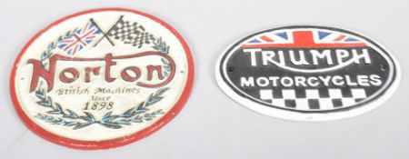 Two replica cast metal signs for Triumph motorcycles and Norton. Largest measures; 22cm.