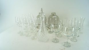 A large collection of wine glasses, pint glasses and more.