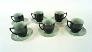 A set of six Branksome coffee cups and saucers in a two tone green and black colourway.