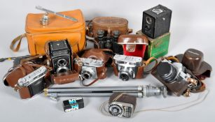 A large collection of assorted cameras and accessories to include; Rolleicord dual lens, Ziess Ikon,