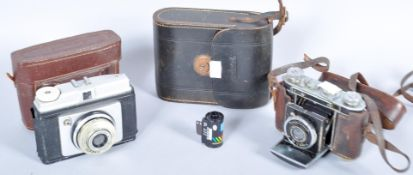 An Ilford cased camera, Certo Dollino cased camera and a case set of binoculars.