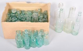 A collection of 19th / 20th Century glass medicinal bottles of varying shapes.