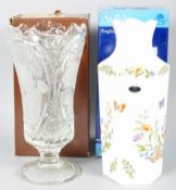 A large Aynsley vase in the original box along with a Beyer cut crystal vase in the original box.
