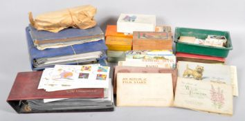 A large collection of stamps, first day covers, cigarette cards and Brooke Bond tea cards.