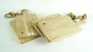Four wooden chopping boards