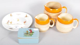 Burleigh ware jugs, Denby hunting lidded pot along with a 'the brownies' golfing plate
