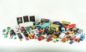 A group of toy cars and other items