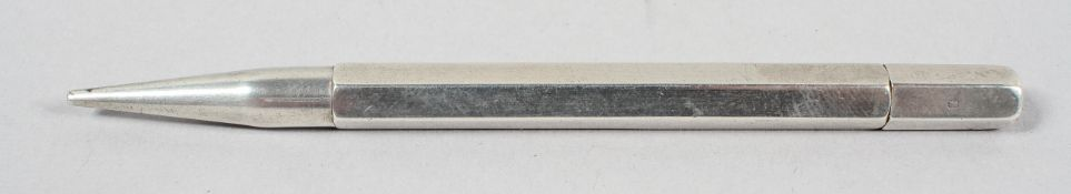 A silver propelling pencil, of plain panel hexagonal form with no clip, London 1947,