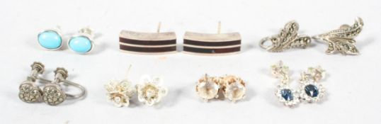A collection of seven pairs of earrings of variable designs. Most are marked for silver / 925.