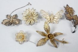 A collection of six abstract design filigree brooches. One marked Sterling. Gross weight: 47.