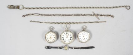A collection of three open face pocket watches.