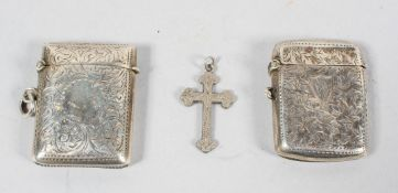 A shaped silver vesta case, engraved all over with scrolling foliates and a vacant round cartouche.