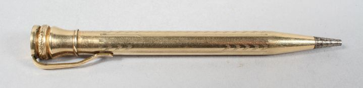 A filled gold propelling pencil, of seal end type, round form with panels of chevron engine turning,