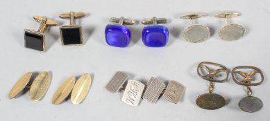 A collection of six pairs of cufflinks of variable designs.