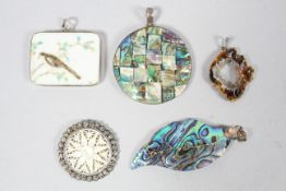 A collection of five large abstract pendants of variable designs.