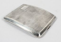 An engine turned decorated shaped silver case with gilt interior, Continental marks,