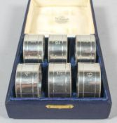 A boxed set of six silver numbered napkin rings by James Dixon and Sons, Sheffield 1917,