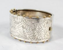 A 19th century aesthetic movement hinged silver bangle,