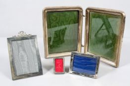 A velvet backed silver plain rectangular photograph frame, with bow tied ribbon cresting,