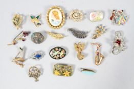 A collection of twenty base metal costume brooches of variable designs.
