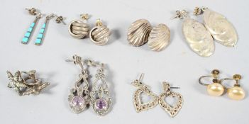A collection of eight pairs of earrings of variable designs. Some are marked for silver.