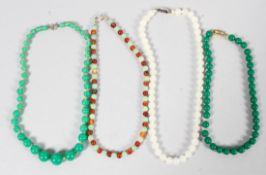 A collection of four beaded necklaces of variable designs together with an unstrung beaded necklace.