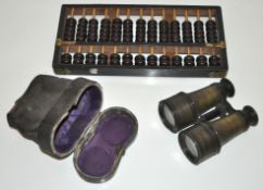 A set of opera glasses and an abacus
