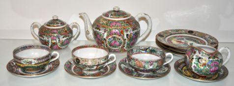 A china famille rose tea set and plates