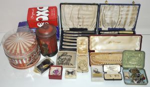 A collection of assorted flatware and costume jewellery
