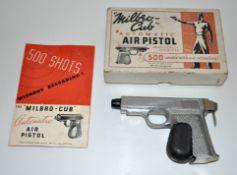 A Milbro-Cub automatic air pistol,