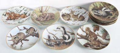 A group of wall plates the forest year by the collectors studio depicting wildlife 19cm