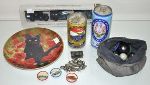 A bag of marbles and RAF beer cans