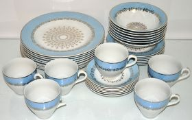 A china tea set with blue band and gilt decoration to include matching dinner plates
