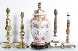 A group of brass and other table lamps