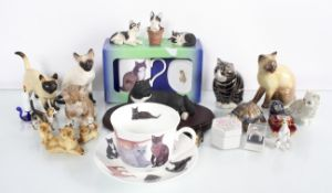 A basket of cat figures