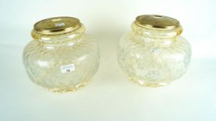 A pair of tinted glass light shades